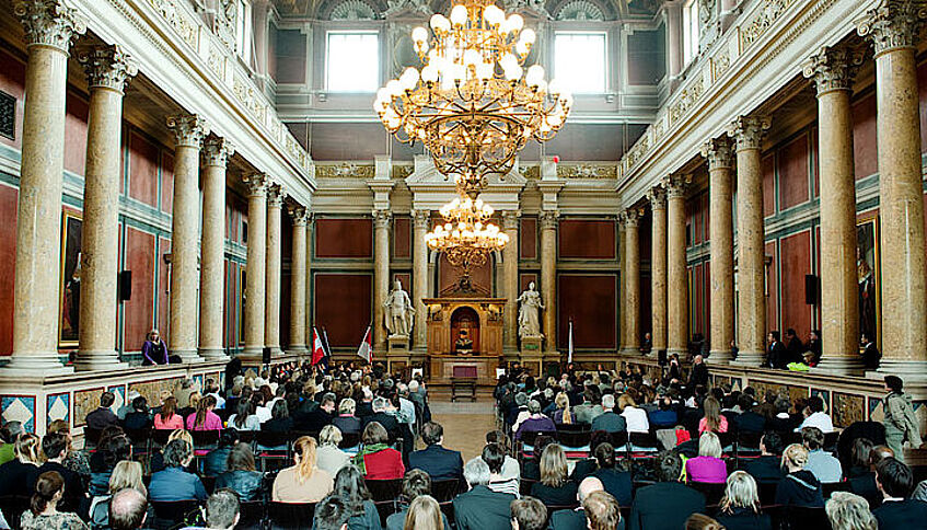 Großer Festsaal at the University of Vienna during a graduation ceremony.